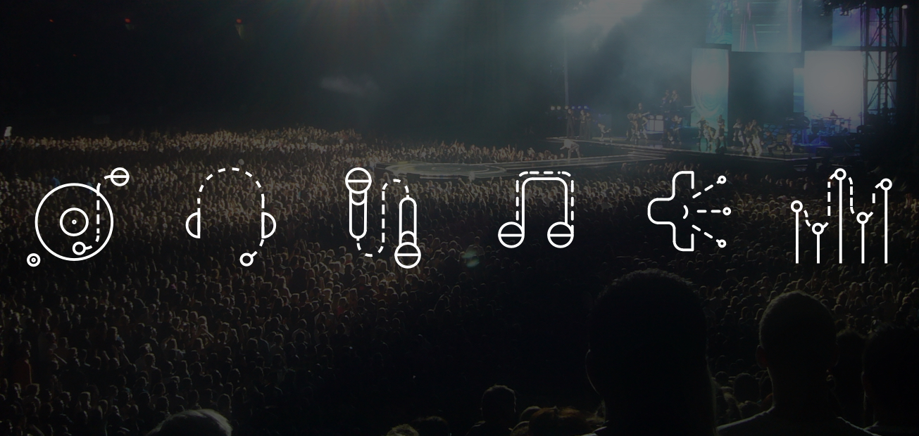 An image of music symbols over on top of a large concert