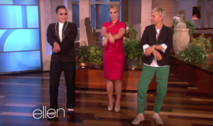 A screen shot of Psy on the Ellen DeGeneres Show teaching Britney Spears and Ellen Gangnam Style