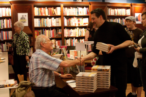 An image of Michael Roux shaking hands at a book signing