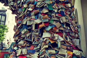 A huge pile of books flowing down from the sky, illustrating that book publishers publish many books each year