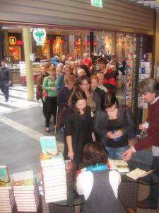 A long line of fans waiting to have their books signed by a particular author