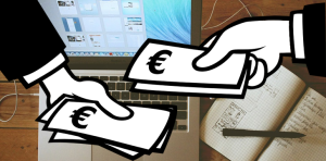 Hands exchanging money over a laptop and notebook