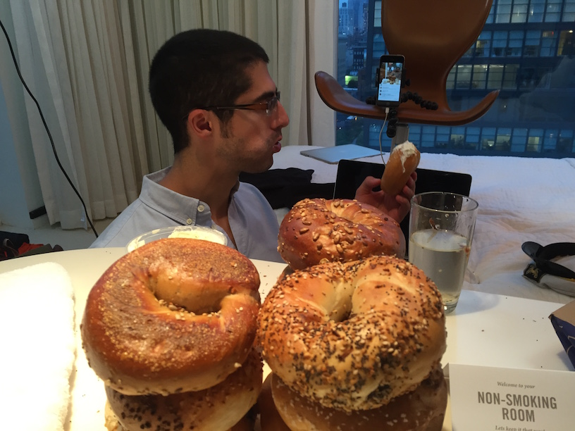 Michael Sorace eating bagels and live streaming to Spoiled NYC Facebook group