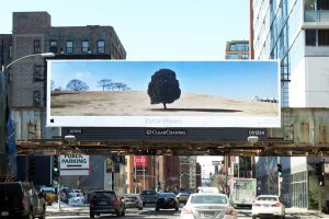 A billboard showing Apple's 'Shot on iPhone' advertising campaign