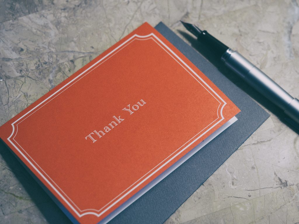 A beautiful red thank you card - represents positive local brand mentions.