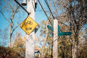 "A ""go slow"" sign in a quiet suburban neighborhood. Illustrates that print-on-demand with dropshipping can have slower delivery times than delivering yourself."