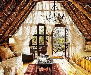 A bohemian interior design for a tree house type Airbnb listing.
